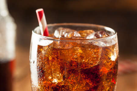 drinking soda: Refreshing Bubbly Soda Pop with Ice Cubes Stock Photo