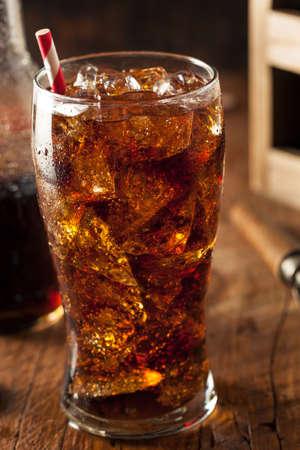 soda splash: Refreshing Bubbly Soda Pop with Ice Cubes Stock Photo
