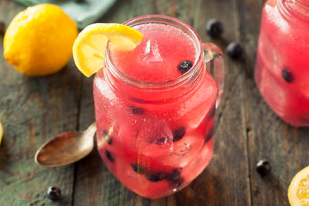 alcohol drinks: Organic Sweet Blueberry Lemonade in a Glass