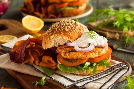Homemade Organic Salmon Burger with Tartar Sauce Stock Photo - 41558539
