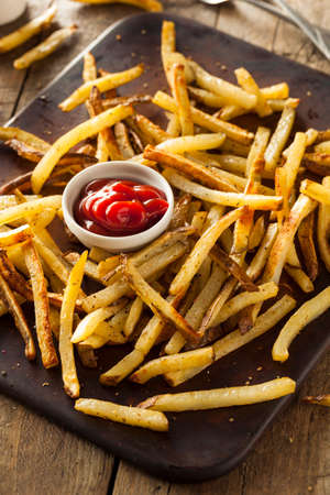ovenbaked: Homemade Oven Baked French Fries with Ketchup Stock Photo