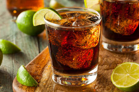 lime slice: Rum and Cola Cuba Libre with Lime and Ice