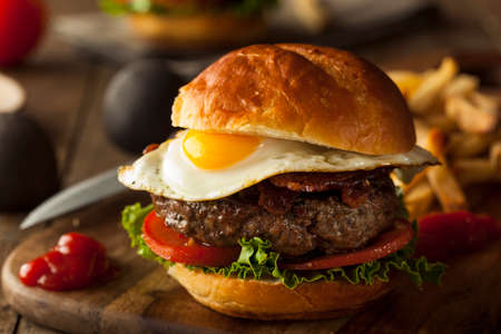 gourmet burger: Homemmade Bacon Hamburger with Egg Lettuce and Tomato