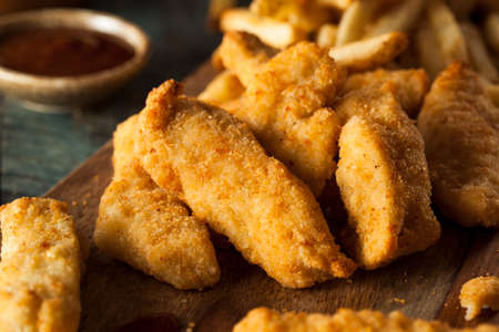 tenders: Homemade Breaded Chicken Tenders with Fries and BBQ Sauce Stock Photo