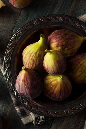 sweet segments: Raw Organic Brown Figs in a Bowl
