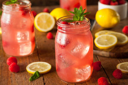 Refreshing Cold Raspberry Lemonade with a Mint Garnish