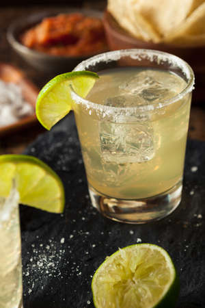 alcoholic beverage: Homemade Classic Margarita Drink with Lime and Salt