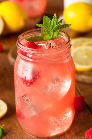 Refreshing Cold Raspberry Lemonade with a Mint Garnish