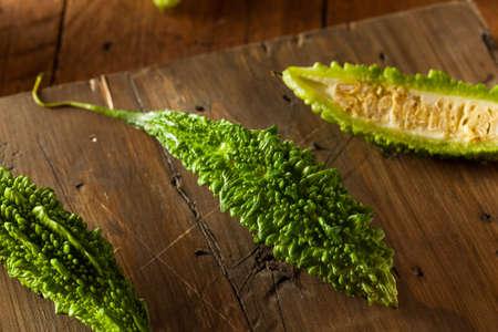 Raw Green Organic Bitter Melon on a Cutting Board