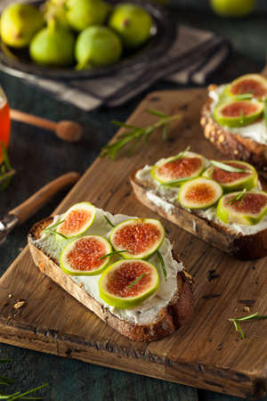 goat cheese: Homemade Fig and Goat Cheese Toast with Rosemary and Honey Stock Photo