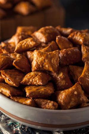 salty: Organic Salty Peanut Butter Pretzel Bites in a Bowl Stock Photo