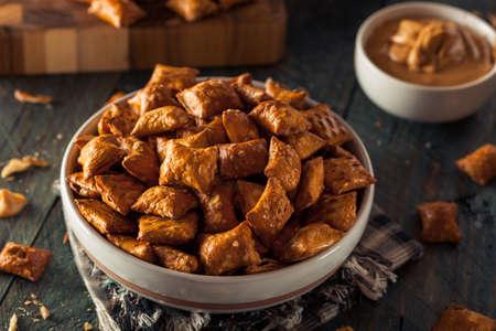 pretzels: Organic Salty Peanut Butter Pretzel Bites in a Bowl Stock Photo