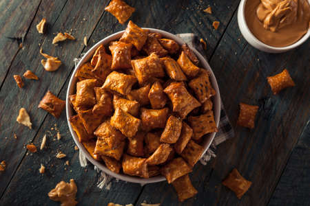 snacking: Organic Salty Peanut Butter Pretzel Bites in a Bowl Stock Photo