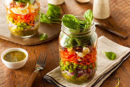 Healthy Homemade Mason Jar Salad with Egg Bacon Lettuce and Veggies