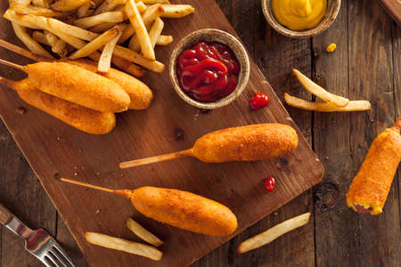 Homemade Organic Corn Dogs with Fries and Ketchup Banco de Imagens - 43784929