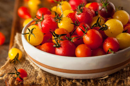 heirloom: Organic Heirloom Cherry Tomatos in a Bowl Stock Photo