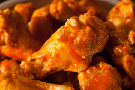 baked chicken: Spicy Homemade Buffalo Wings with Dip and Beer