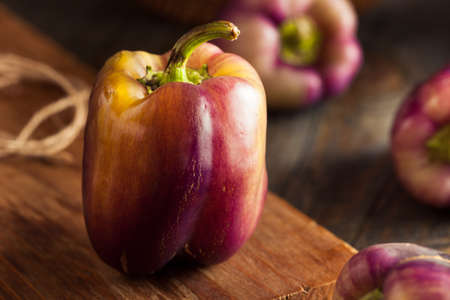 bell peppers: Organic Purple Bell Peppers on a Background Stock Photo