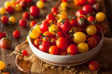 heirloom: Organic Heirloom Cherry Tomatos in a Bowl Stock Photo