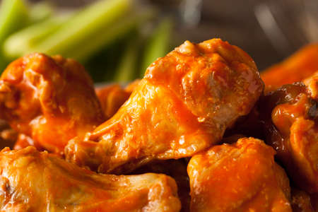 Spicy Homemade Buffalo Wings with Dip and Beer Banco de Imagens - 44055976