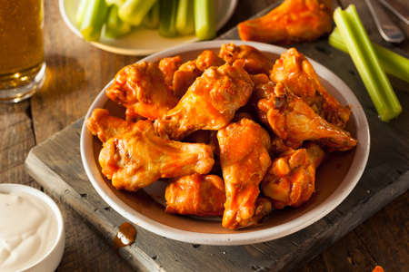 fried chicken wings: Spicy Homemade Buffalo Wings with Dip and Beer