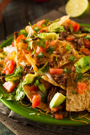 NACHO: Loaded Beef and Cheese Nachos with Cilantro and Lime