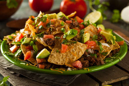nacho chip: Loaded Beef and Cheese Nachos with Cilantro and Lime