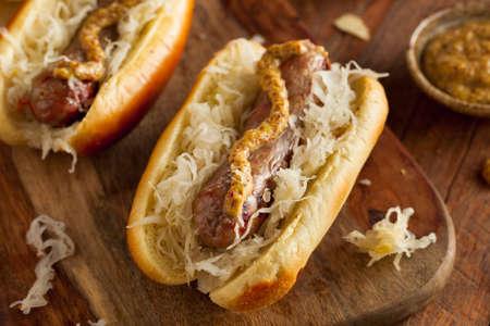 hotdog: Beer Bratwurst with Sauerkraut and Spicy Mustard