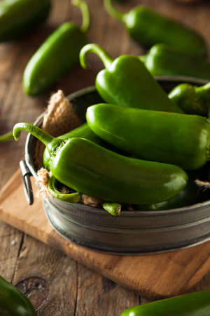jalapeno: Organic Green Jalapeno Peppers in a Bowl