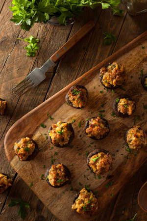 appetizers: Homemade Sausage Stuffed Mushrooms with Cheese and Parsley