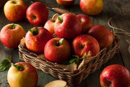 Raw Red Fuji Apples in a Basket Stock Photo