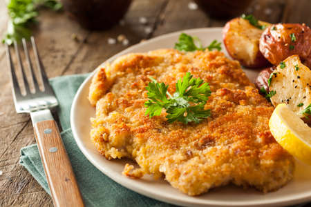 Homemade Breaded German Weiner Schnitzel with Potatoes Stock Photo