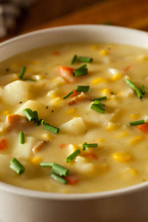 chowder: Hot Homemade Corn Chowder in a Bowl Stock Photo
