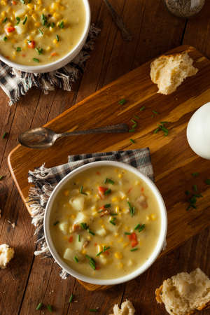 sweetcorn: Hot Homemade Corn Chowder in a Bowl Stock Photo