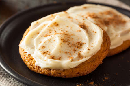 Homemade Pumpkin Spice Cookies with Cream Cheese Frosting Stock Photo