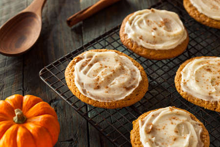 cream cheese: Homemade Pumpkin Spice Cookies with Cream Cheese Frosting Stock Photo