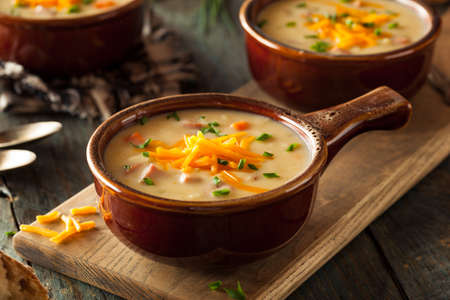 vegetable soup: Homemade Beer Cheese Soup with Chives and Bread Stock Photo