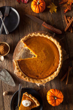 orange fruit: Festive Homemade Pumpkin Pie with Whipped Cream