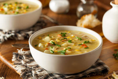 prepared potato: Hot Homemade Corn Chowder in a Bowl Stock Photo