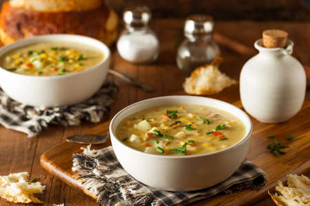 potato soup: Hot Homemade Corn Chowder in a Bowl Stock Photo