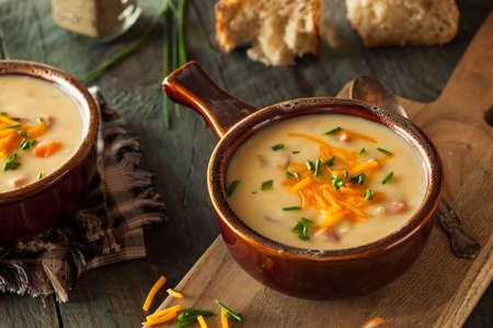 soup: Homemade Beer Cheese Soup with Chives and Bread Stock Photo
