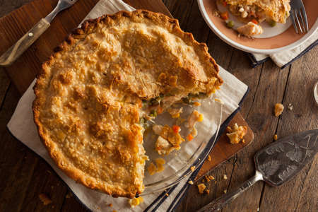 baked chicken: Hearty Homemade Chicken Pot Pie with Peas and Carrots Stock Photo