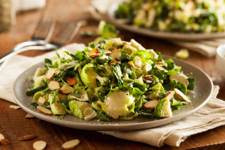 Kale and Brussel Sprout Salad with Almons and Lemon Dressing