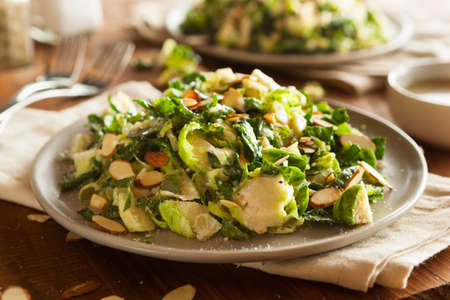 brussel: Kale and Brussel Sprout Salad with Almons and Lemon Dressing