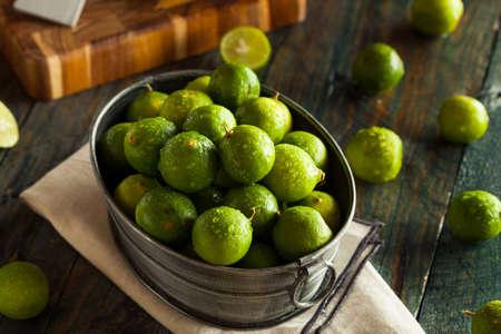 Raw Green Organic Key Limes in a Bowl