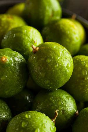 florida citrus: Raw Green Organic Key Limes in a Bowl