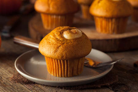 muffin: Homemade Pumpkin Spice Muffins with Cream Cheese Frosting
