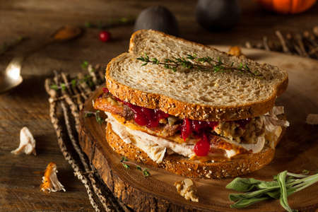 Homemade Leftover Thanksgiving Sandwich with Turkey Cranberries and Stuffing Stock Photo