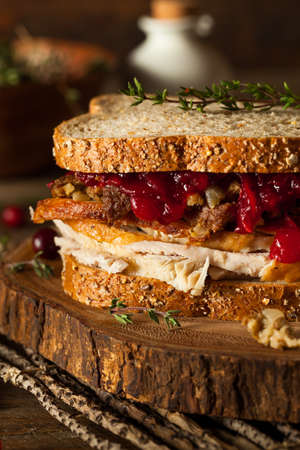 stuffing: Homemade Leftover Thanksgiving Sandwich with Turkey Cranberries and Stuffing Stock Photo