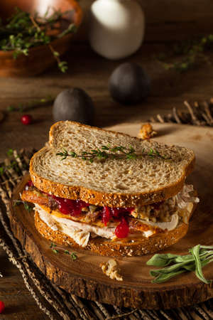 leftovers: Homemade Leftover Thanksgiving Sandwich with Turkey Cranberries and Stuffing Stock Photo
